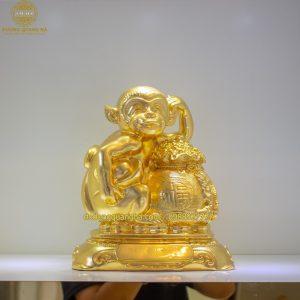 Tượng Khỉ đồng ôm bị tiền dát vàng 9999