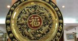 Ý nghĩa của mâm đồng tứ linh chữ Phúc trong phong thủy